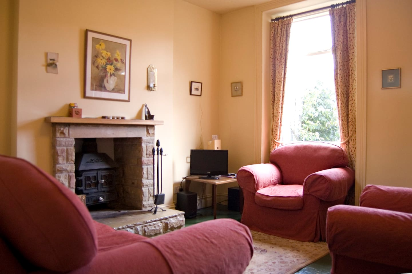 Comfy sitting room with stove