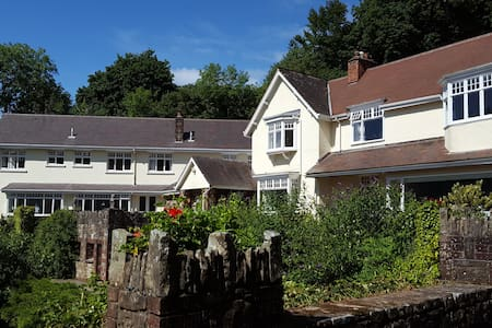 Spacious licensed country house with superb views