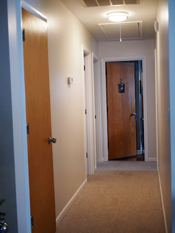 there are a total of three other guest bedrooms down this hallway. The gray room is at the end of the hallway, the purple room is the first door on the right. The third bedroom, the king too has their own en suite bath. The hallway bath is the second door on the right.