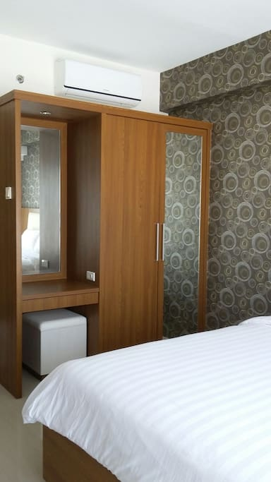 Wardrobe, air conditioner and bed