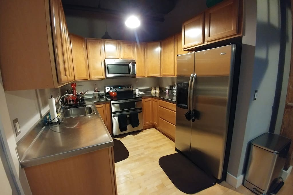 Kitchen, complete with coffee, creamer, kitchenware, and appliances.