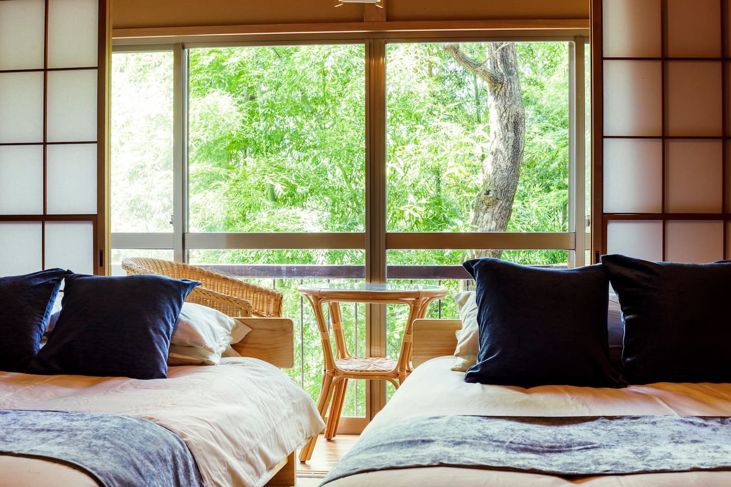 A bedroom is just next to the trees, offering some comfortable space for you to relax and sleep.