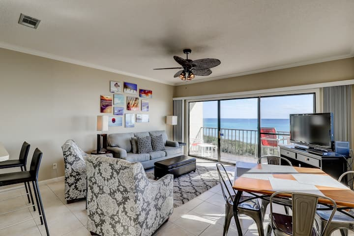 Beachfront corner condo with stunning gulf view & shared pool!