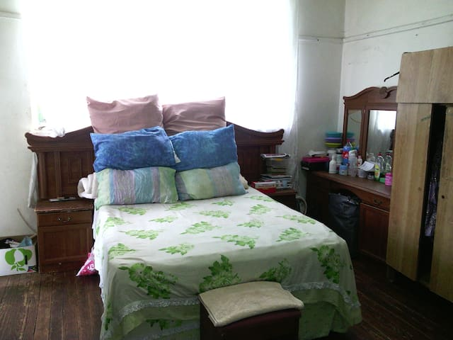 a bed room with double bed.
