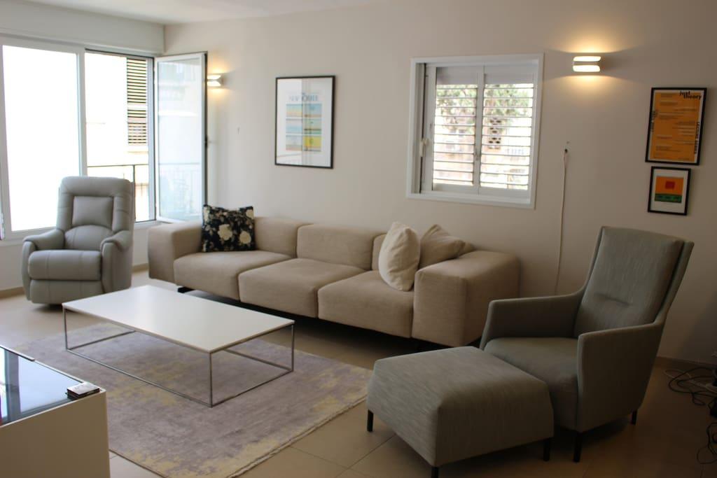 Sofa, la-Z-Boy, and an armchair