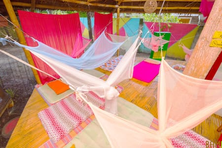 Sunny SINGLE BED in a Nature-Based Dorm (GLAMPING) - Puerto Princesa - Hut