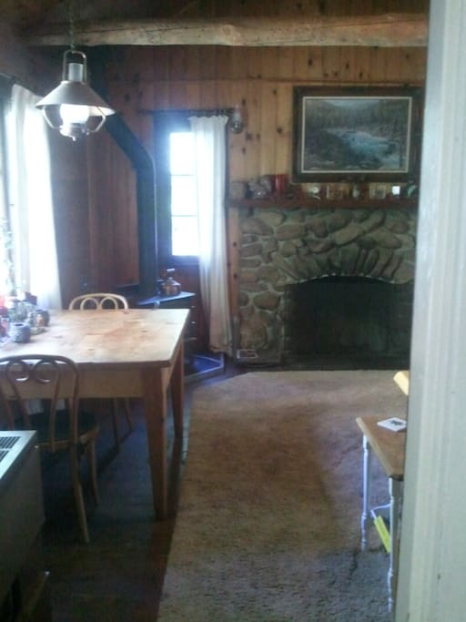 from kitchen, natural stone fireplace, custom wood furniture