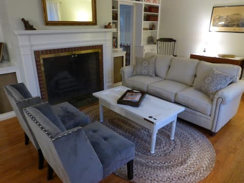 One of two large living rooms with many cozy spots for conversation or quiet reading.