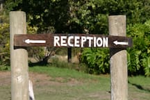 Look out for the Reception sign at the Main House.