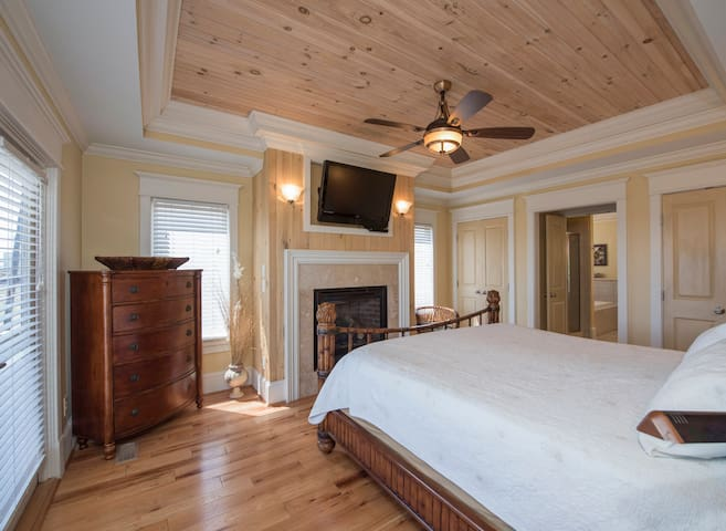 Master bedroom takes up half of the first level of home.