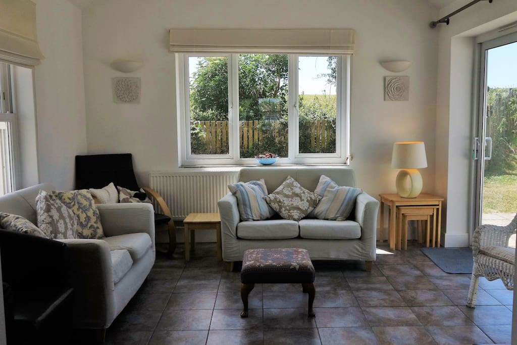 Living room with doors to patio