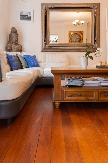 Lounge room with coffee table - travel, camping, cooking and fashion magazines