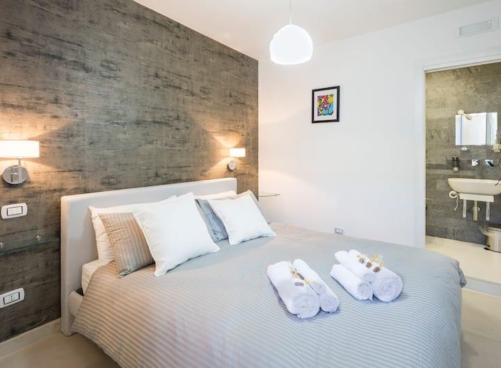 Tripla con bagno privato in camera e balconcino