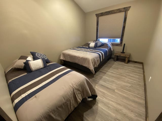 The second bedroom has a single bed and a double bed