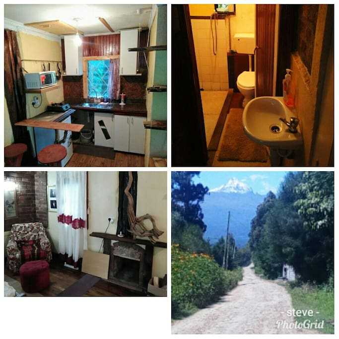fully equipped kitchenette functional fireplace clean b/room with hot shower..mountain view from the road