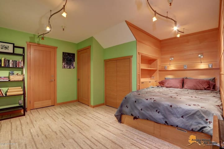 Bedroom with lights above bed