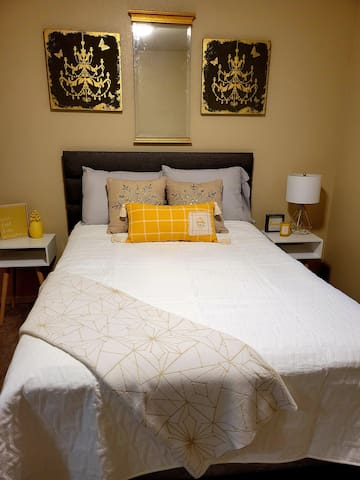Main upper level. Second bedroom.  A closer view of the bed with all new bedding, zippered mattress & pillow protectors, a duvet cover with your choice of a down like blanket, a soft plush blanket or a quilted blanket plus   many pillows & a throw.