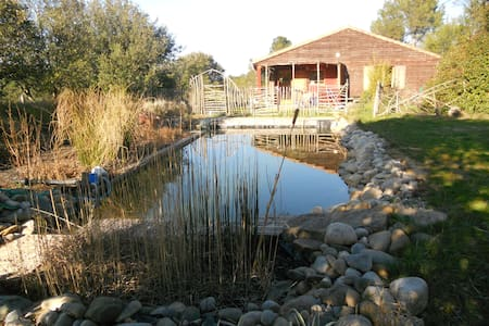 wooden house and natural swimming pool - Palaja - Huis