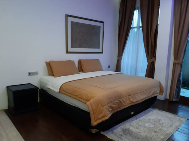 Room with 1 king size bed, wooden floors that make you feel warm in the cold mountains, with a terrace room & bathroom inside the room equipped with shower and water heater