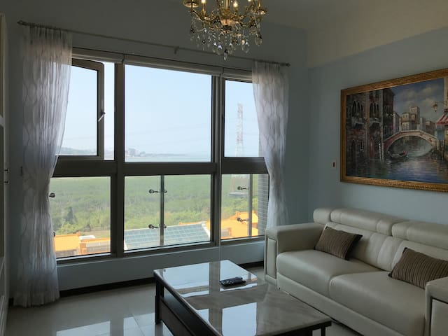 Living room have very big picture window with beautiful river and mountain view