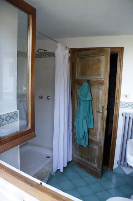 guest bathroom overlooking the balcony (cover photo: window in the middle)