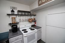 Full kitchen with Keurig coffee pot.