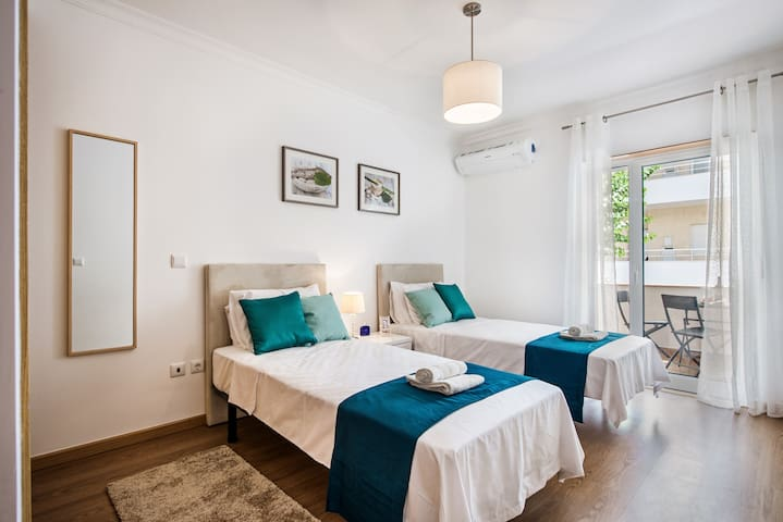 Twin single beds and a spacious bedroom