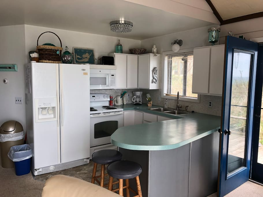 New updated kitchen with view of the water