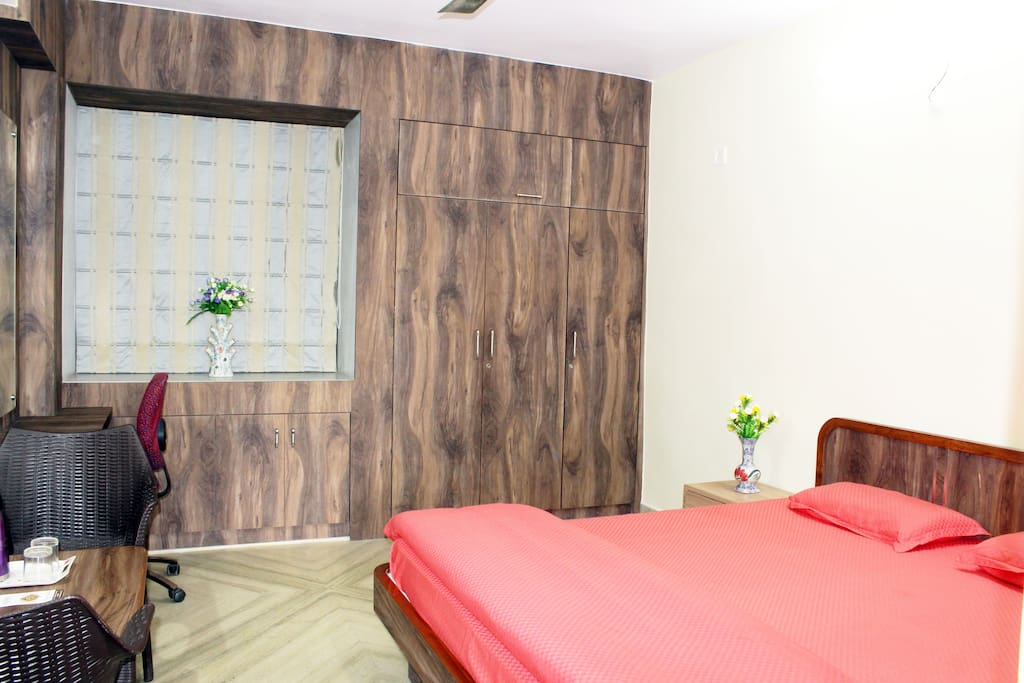 Room is stocked with Comfortable King size bed with High Quality Mattress, Mattress Protector, Bedsheet, Comforter & Pillows alongwith Dressing cum Study Table, Chairs, Centre & Side tables, Wardrobes and Black-out Curtains.