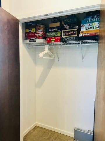 Closet with extra hangers and lots of board games.
