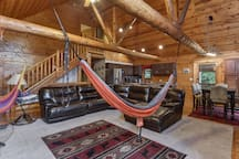 Hammocks in the living room hanging from rafters.