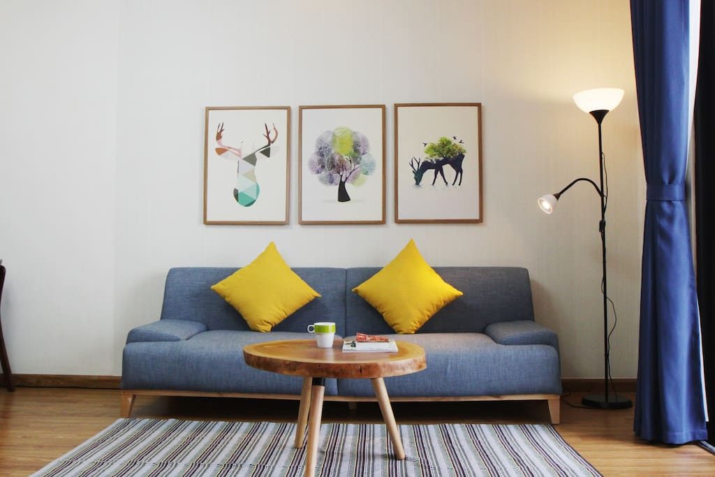 Living room with long couch, easily fit a 1.9m adult