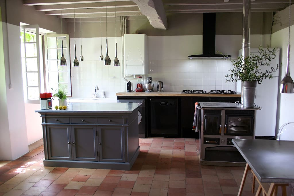 A well equipped cooks kitchen with two gas hobs, fan oven and Italian log burning stove for off season rentals.