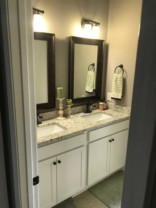 Bathroom with dual vanity.  Attached is a separate room with shower and toilet