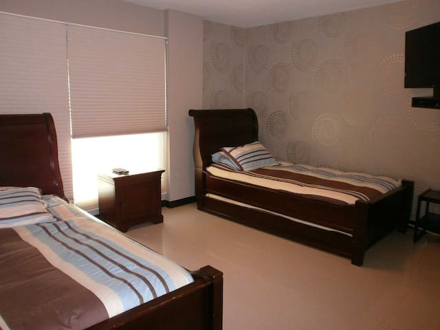 Third bedroom with two twin-size beds.