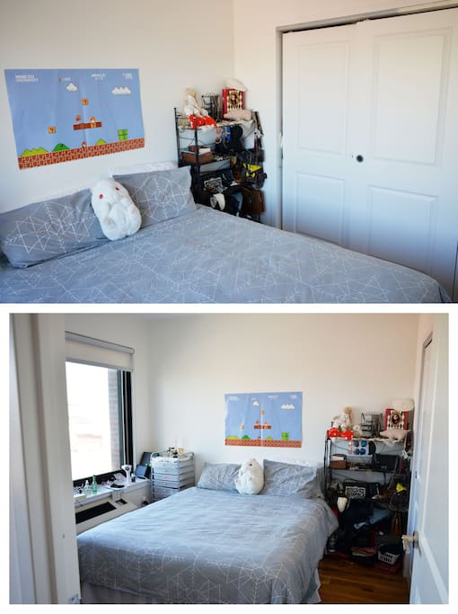 Bedroom w/Queen-sized bed, full closet, & view of Manhattan