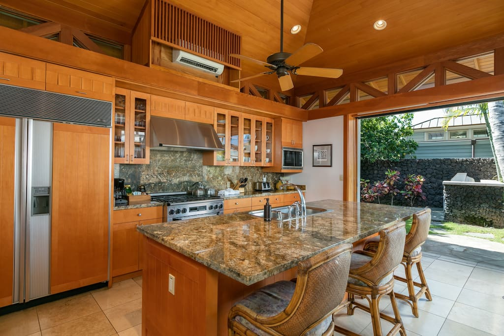 Large gourmet kitchen - stocked with spices and oils