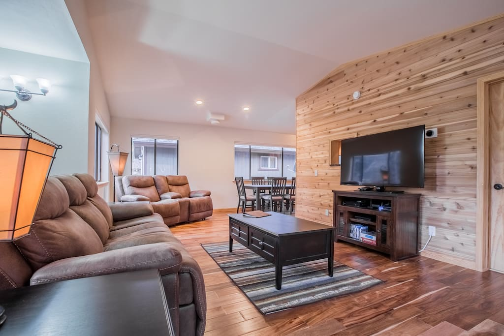 The upstairs includes a half bath, newly furnished living area, dining table, and kitchen