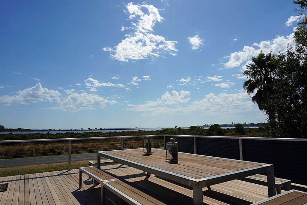 The large sunny deck has views over Swan Bay and a great bbq.