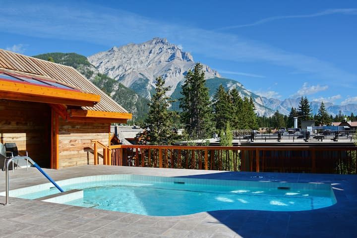 Escape to the Rockies in this Central Room | Rooftop Hot Pools On-Site
