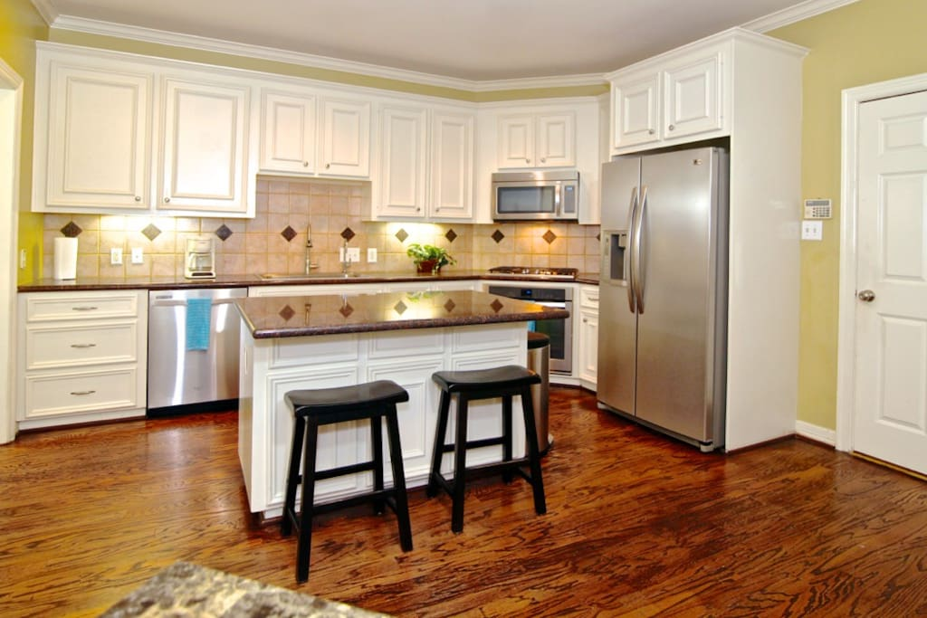 fully equipped kitchen with modern appliances, cookware, flatware etc