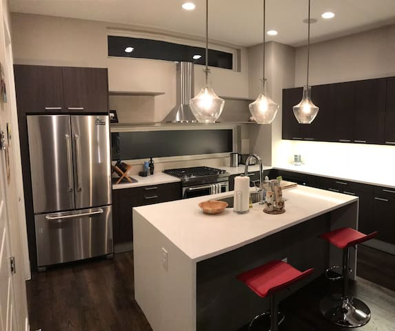 Kitchen, new gas range, double oven, microwave and dishwasher