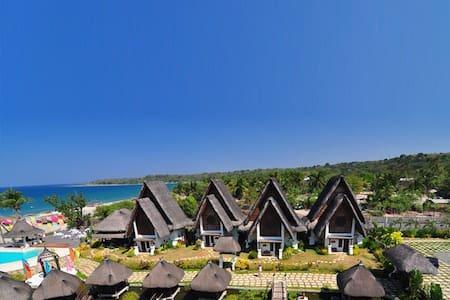 A charming beach front Bali-inspired pool villa