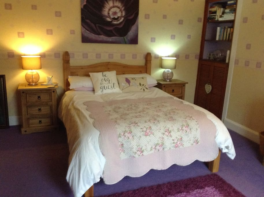 Double bed in this room . Ground floor