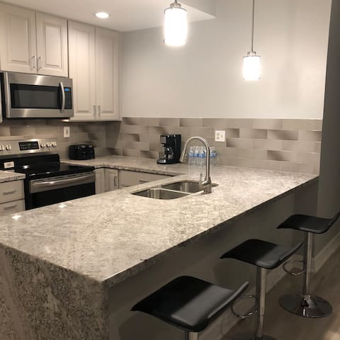 Beautiful waterfall granite in the kitchen. Fully stocked for your convenience.
