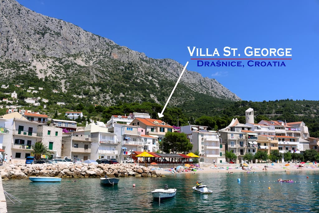 Villa St. George Apartments are on the top two floors of this building with the red roof, just 50 meters from the sea