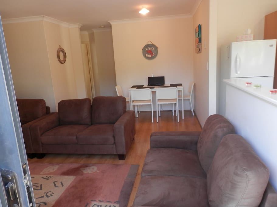 Easy care home with lounge and dining area leading off the kitchen.