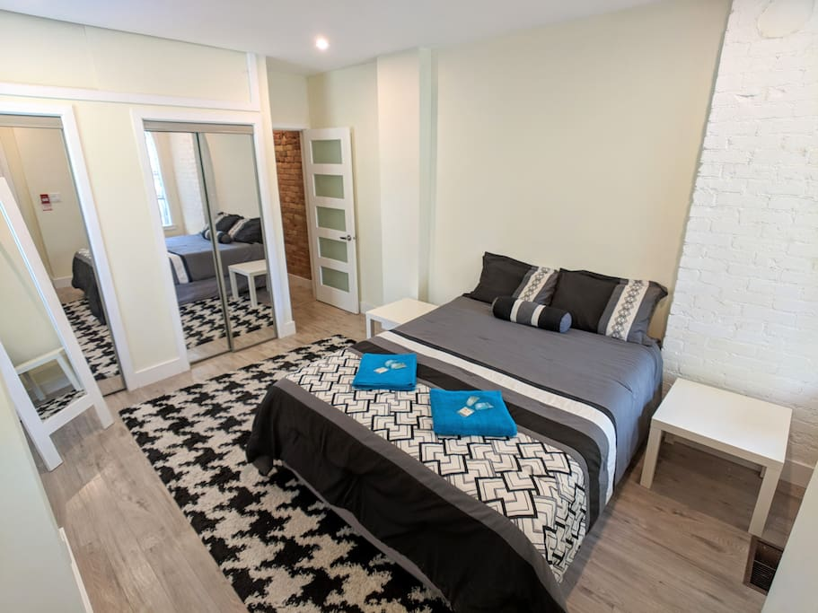 Comfortable double bed and wardrobe in the bedroom