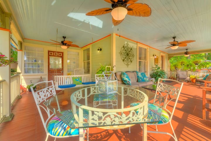 The huge L shaped front porch has plenty of seating and a dining area that seats four.