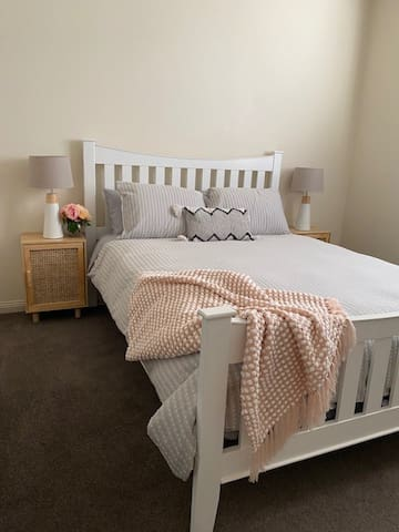 Queen bed with walk in robe and full length mirror.